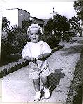 "Photo of Jack Barnes in 1944 when living in Long Beach, Calif where his Dad was stationed in the Navy. His Mom labled the picture as ""all dressed up in his Lord Faunteroy suit."