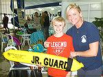 Carson Barnes completes Jr Lifeguard Day with instructor and Aquatics Director Colby Phillips.