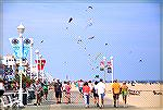 Looking north along Ocean City, Maryland boardwalk. Kites.