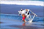 Ocean City Maryland lifeguard lugs stand back from rising tide.