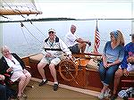 Tom Yenney takes the helm of the historic Cat Boat Selina II in St. Michaels.